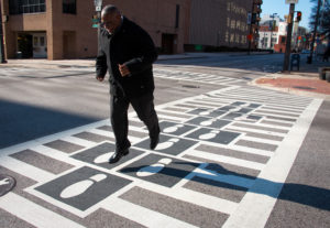 Hopscotch Crosswalks Colossus man jumping